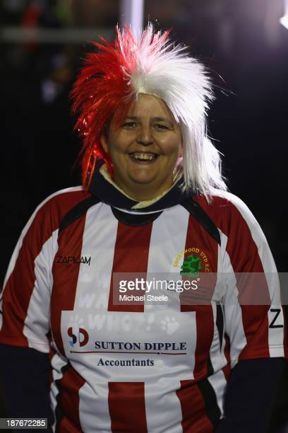 A supporter of Shortwood United shows off her colours during the FA Cup First Round match between Shortwood United and Port Vale at Meadowbank...