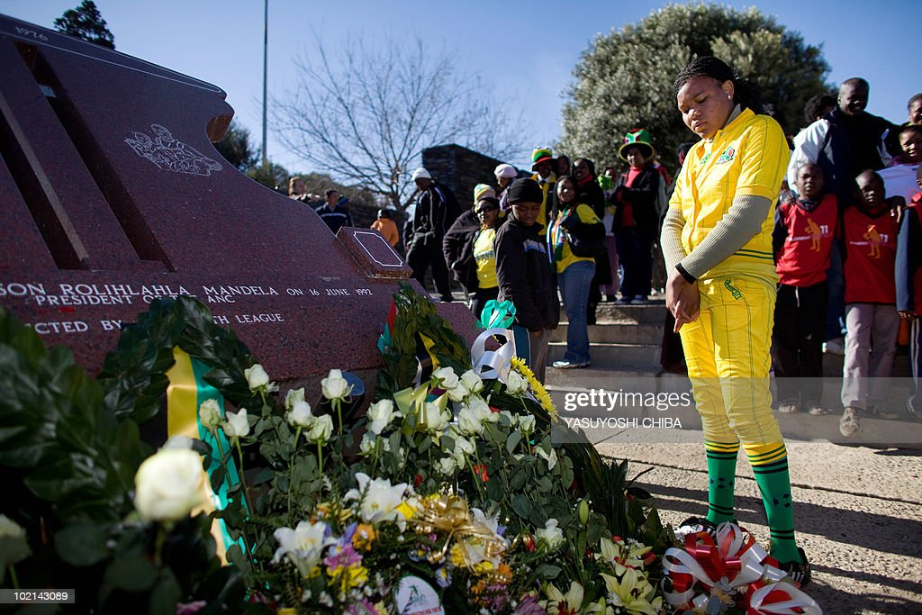 A supporter of South Africa pays her respects at a monument in honour of Hector Pieterson at the Hector Pieterson Museum in Soweto on June 16, 2010. South Africa paused from its World Cup celebrations today to observe the 34th anniversary of the Soweto uprising, a student protest whose tragic ending galvanised the anti-apartheid movement. On June 16, 1976, thousands of students from the black township of Soweto gathered to march in protest at being forced to go to school in Afrikaans, the language of the white-minority regime. Police opened fire on the unarmed protestors, killing hundreds -- including Hector Pieterson, the first to die in the violence.
