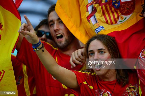 A supporter of Spain cheers during the FIFA Confederations Cup Brazil 2013 semifinal football match between Spain and Italy at the Castelao Stadium...