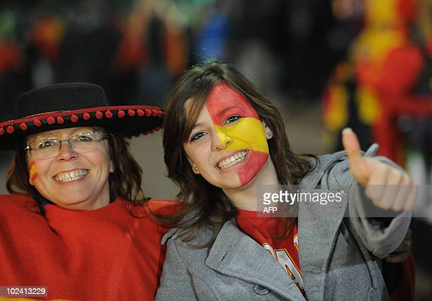 A supporter of Spain with the national colours on her cheek smiles outside Loftus Verfeld stadium in Tshwane/Pretoria moments before the start of the...