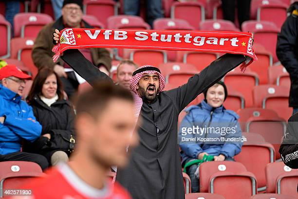 A supporter of Stuttgart cheers prior to the Bundesliga match between VfB Stuttgart and Borussia Moenchengladbach at MercedesBenz Arena on January 31...