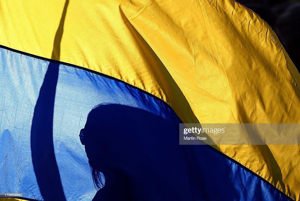 A supporter of Sweden is seen befind a swedish flag before the UEFA Women's Euro 2013 group A match between Sweden and Italy at Orjans Vall on July 16, 2013 in Halmstad, Sweden.