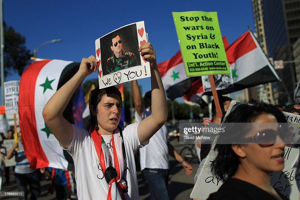 A supporter of Syrian President Bashar Hafez al-Assad expresses love for the president at a rally to urge Congress to vote against a limited military strike against the Syrian military in response to allegations that Assad has used sarin gas to kill civilians on September 7, 2013 in Los Angeles, California. The Obama administration claims to have clear evidence that the Syrian military broke international law by killing nearly 1,500 Syrian civilians, including at least 426 children, in a chemical weapons attack on August 21, and is seeking the support of Congress for a missile strikes to prevent future chemical weapons attacks by the regime and other nations.