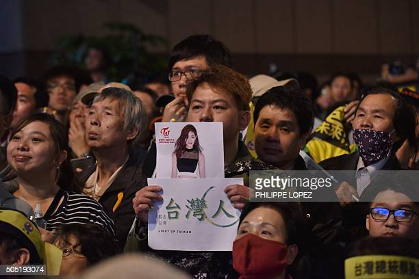 A supporter of Taiwan's Democratic Progressive Party holds up a placard of Kpop artist Chou Tzuyu a member of the South Korean allgirl band TWICE and...