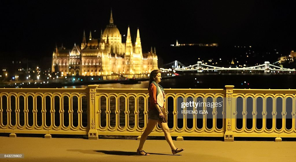 A supporter of team Hungary walks away June 26, 2016 in Budapest following Hungary's loss in their Euro 2016 football match against Belgium that was played in Toulouse, France. Hungary lost 0-4. / AFP / FERENC