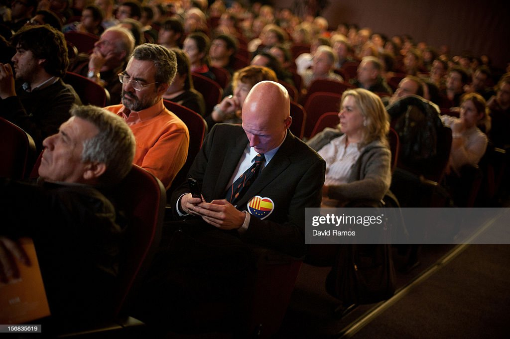 A supporter of the Anti-separatist political party Citizens checks his mobile phone during the closing rally on November 22, 2012 in Barcelona, Spain. Over 5 million Catalans will be voting in Parliamentary elections on November 25, with opinion polls showing majority support for pro-independence parties.