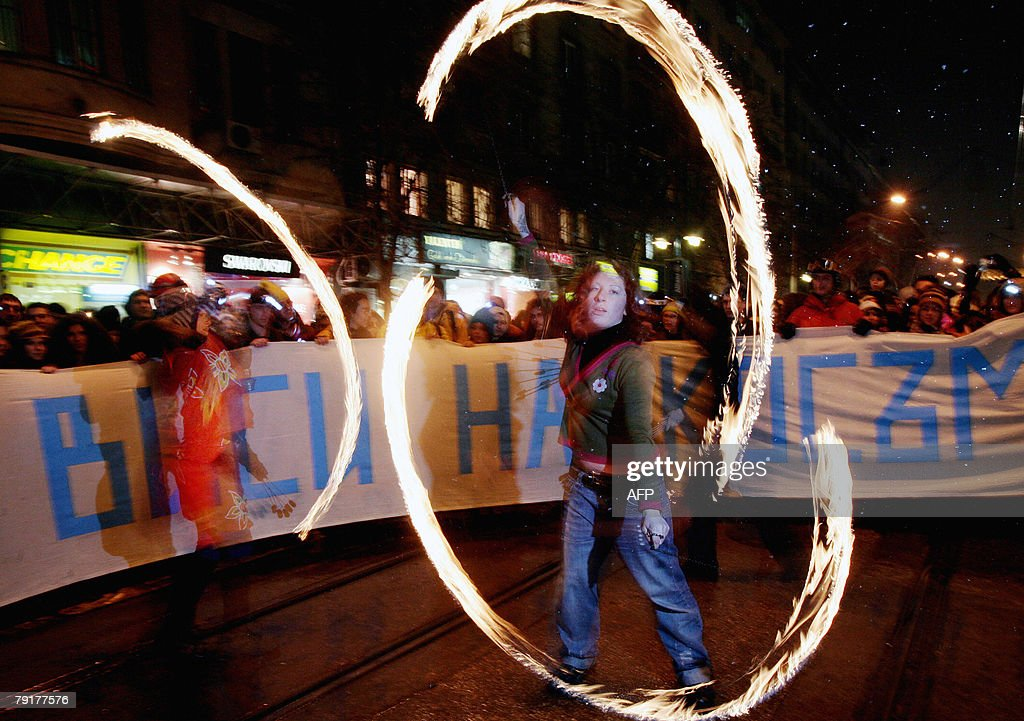 A supporter of the Bulgarian environmental organization 'For the Nature' twirls fire chains during a protest in central Sofia, 23 January 2008. Hundreds of supporters of theorganization gathered to protest against building up of the Bulgaria's Rila National Park.