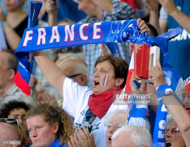 A supporter of the French basketball team holds a scarf to cheer up her team during the Women's Euro Basketball match between France and Turkey on...