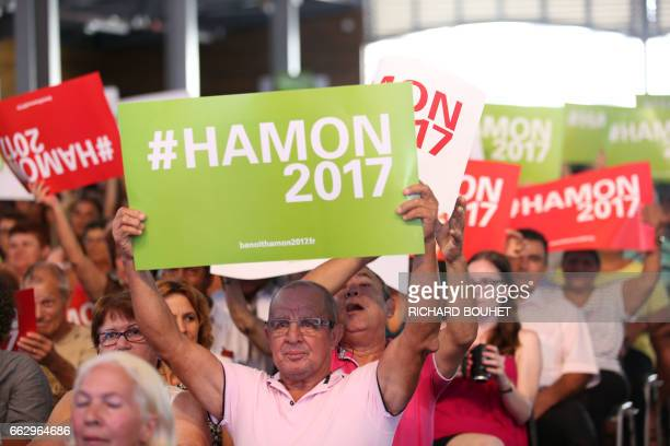 A supporter of the French presidential election candidate for the leftwing French Socialist party Benoit Hamon holds a placard in SaintJoseph on...