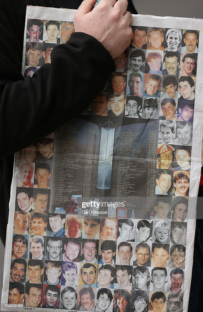 A supporter of the Hillsborough Disaster Support Group holds a copy of a newspaper displaying images of the 96 football fans who lost their lives in the disaster outside the High Court on December 19, 2012 in London, England. An application presented by the Attorney General, Dominic Grieve to Lord Chief Justice, Lord Judge has resulted in the quashing of the original accidental death verdict and an order for fresh inquests. The Hillsborough disaster occurred during the FA Cup semi-final tie between Liverpool and Nottingham Forest football clubs in April 1989 at the Hillsborough Stadium in Sheffield, which resulted in the deaths of 96 football fans.