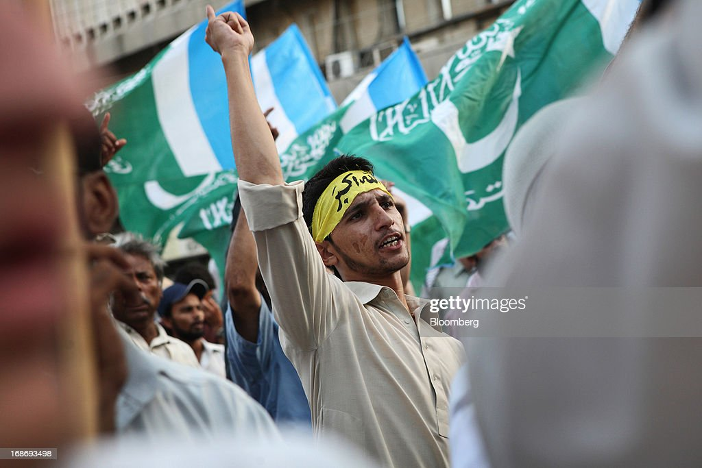 A supporter of the Jamaat-e-Islami (Islamic Party) shouts slogans during a demonstration in Karachi, Pakistan, on Monday, May 13, 2013. Nawaz Sharif was headed for a record third term as prime minister of Pakistan as unofficial results from a landmark election gave him the convincing win he sought to tackle a slumping economy and growing militancy. Photographer: Asim Hafeez/Bloomberg via Getty Images