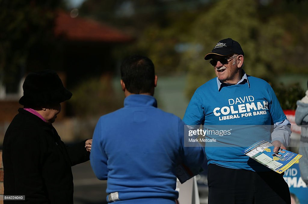A supporter of the Liberal party campaigns in the electorate of Banks at Revesby YMCA on July 2, 2016 in Sydney, Australia. Voters head to the polls today to elect the 45th parliament of Australia.