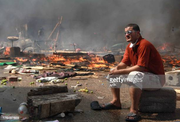 A supporter of the Muslim Brotherhood and Egypt's ousted president Mohamed Morsi looks on during clashes with security forces in Cairo on August 14...