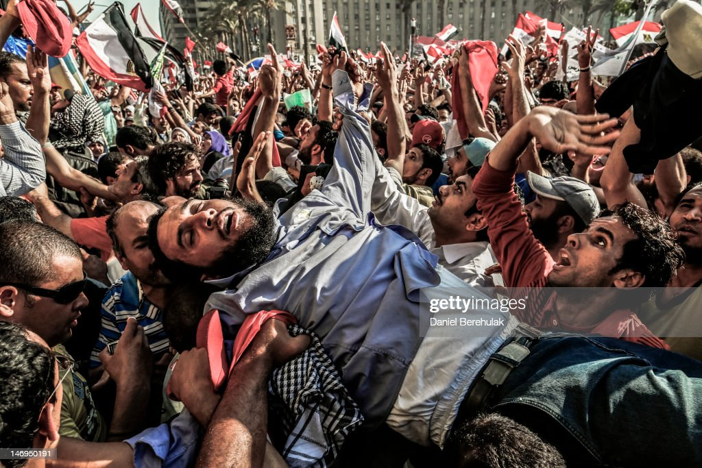 A supporter of the Muslim Brotherhood overcome by emotion is carried onto the stage as Egyptians celebrate the election of their new president Mohamed Morsi in Tahrir Square on June 24, 2012 in Cairo, Egypt. Official election results today confirmed that Mohamed Morsi is to be the next president of Egypt. Morsi received over 13 million or 51.7% of the votes, while his main rival, former Prime Minister Ahmed Shafiq, received 48.27 percent.
