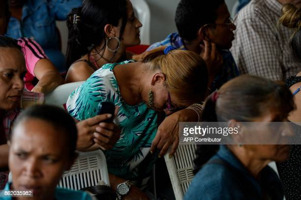 A supporter of the opposition's candidate for governor for the state of Miranda Mayor of Caracas' Sucre Municipality Carlos Ocariz shows her...