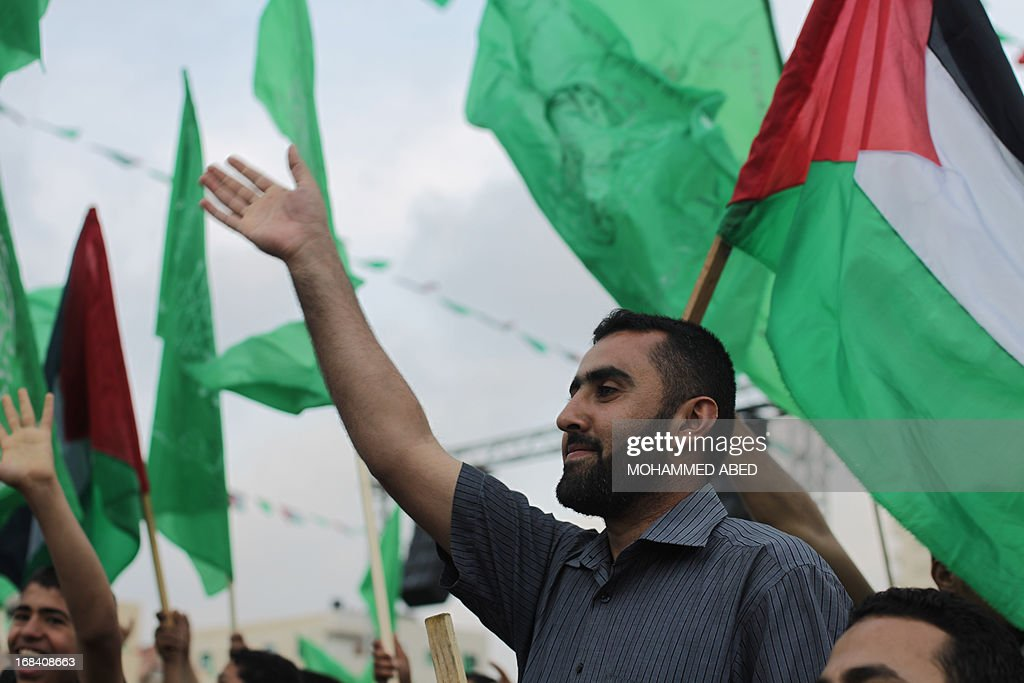 A supporter of the Palestinian Islamic group Hamas attends a festival of the International Association of Muslim Scholars head by Muslim cleric Yusuf al-Qaradawi on May 9, 2013 in Gaza City. Al-Qaradawi arrived on May 8, 2013 for his first visit to Gaza Strip with a delegation of Muslim scholars and warned that nobody was allowed to cede 'any part of Palestine'.