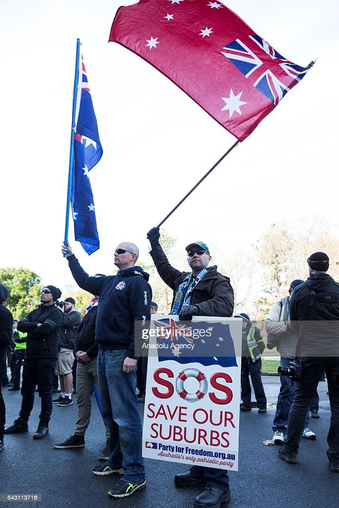 A supporter of the party for freedom waves his flag during a protest organized by the anti-Islam True Blue Crew supported by the United Patriots Front in Melbourne, Australia on June 26, 2016.
