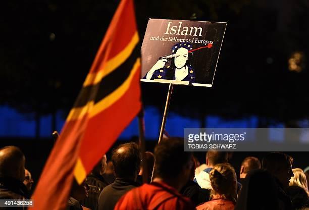 A supporter of the PEGIDA movement 'Patriotische Europaeer gegen die Islamisierung des Abendlandes' which translates to 'Patriotic Europeans Against...