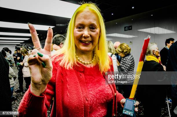 A supporter of the people's Party mimics the Spanish flag with yellow hair and red dress The Popular Party of Catalonia has counted with the presence...