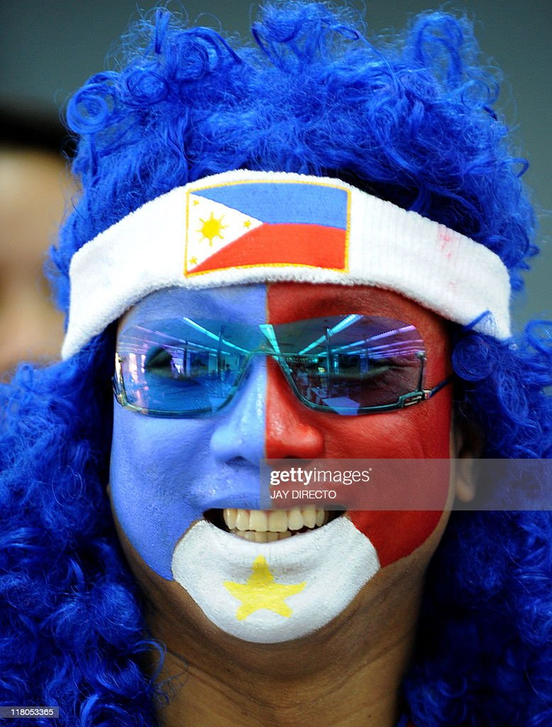 A supporter of the Philippines with his face painted in the colours of the national flag as his team plays against Sri Lanka during their 2014 FIFA World Cup qualifying football match in Manila on July 3, 2011. The Philippines won 4-0 AFP PHOTO / JAY DIRECTO