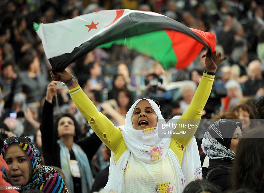 A supporter of the Polisario Front separatist movement waves the party's flag as she shouts slogans at the opening of the World Social Forum (WSF) on March 26, 2013 in Tunis. More than two years after the Jasmine revolution, tens of thousands of people are expected for the WSF, dubbed the forum of 'dignity', a watchword of the Tunisian uprising that inspired revolts across the Arab world.