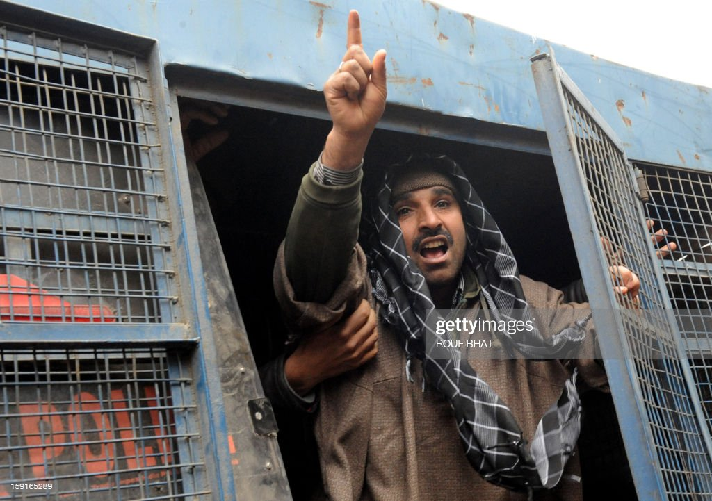 A supporter of the pro-independence Jammu and Kashmir Libration Front (JKLF) shouts anti-India slogans from a police van during a 'jail bharo' agitation to tempt police for their arrest, in Srinagar on January 9, 2013. The agitation was held to protest against the life sentences to Kashmiri prisoners by the Indian courts. At least 29 Kashmiri men are in jails serving life sentences, according to Kashmiri human rights group. AFP PHOTO/Rouf BHAT