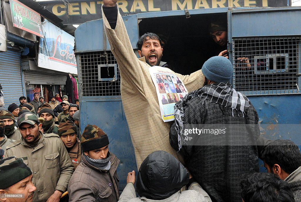 A supporter of the pro-independence Jammu and Kashmir Libration Front (JKLF) shouts anti-India slogans from a police van during a 'jail bharo' agitation to tempt police for their arrest in Srinagar on January 13, 2013.The agitation was held to protest against the life sentences to Kashmiri prisoners by the Indian courts. At least 29 Kashmiri men are in jails serving life sentences, according to Kashmiri human rights group. AFP PHOTO/Rouf BHAT