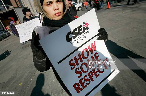 A supporter of the Transport Workers Union holds a sign during a march in front of State Supreme Court December 22 2005 in New York City Subways and...