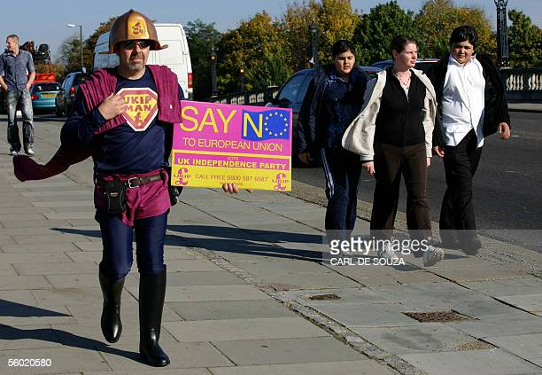 A supporter of the UK Independence Party protests outside Hampton Court Palace Surrey on the day of an informal European Union summit meeting 27...