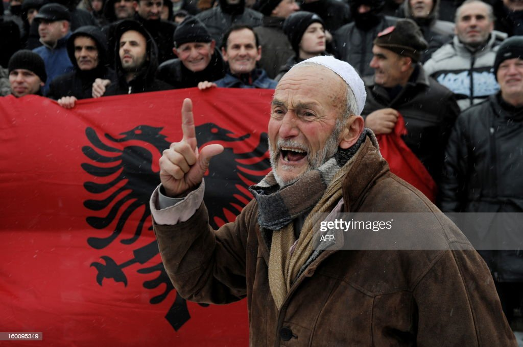 A supporter of the 'Vetevendosje' (Selfdetermination) shouts slogans at a protest in Pristina on January 26, 2013 to support the Albanians in the Valley of Presevo against the removal of the martyrs memorial by the Serb gendarmerie in Presevo. More than 3,000 ethnic Albanians protested on January 21, 2013 against Belgrade's removal of a memorial honouring their guerrillas and demanded 'demilitarisation' of this tense ethnically-mixed southern region of Serbia.