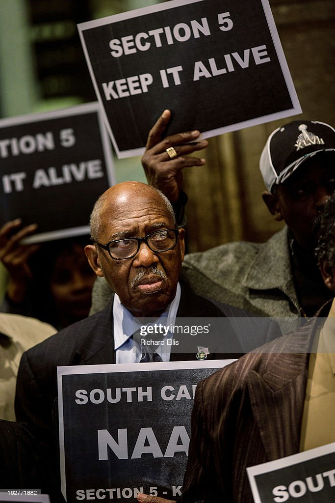 A supporter of the Voting Rights Act rallies in the South Carolina State House on February 26, 2013 in Columbia, South Carolina. The rally comes a day before the U.S. Supreme Court hears a case that could end a requirement for South Carolina and other states with histories of discriminatory voting practices to get federal approval for any new voting laws.