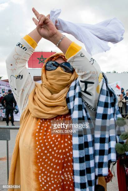 A supporter of the Western Sahara's Polisario Front gestures during a demonstration outside the court in Sale on March 13 in support of the 25...