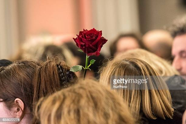 Supporter of the winner of the leftwing primaries ahead of France's 2017 presidential elections Benoit Hamon on January 29 wave roses at his campaign...