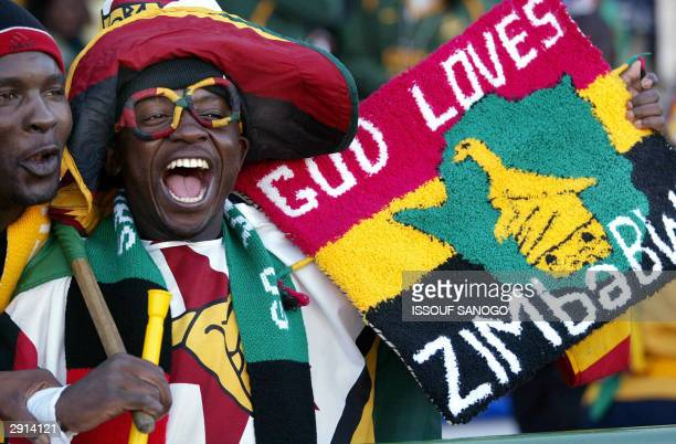 A supporter of the Zimbabwean national soccer team sings 29 January 2004 at the Sfax stadium during their African Nations Cup match against Zimbabwe...