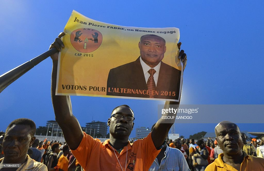 Supporter of Togo's opposition leader and Alliance for National change candidate for presidential election <a gi-track='captionPersonalityLinkClicked' href=/galleries/search?phrase=Jean-Pierre+Fabre&family=editorial&specificpeople=2329955 ng-click='$event.stopPropagation()'>Jean-Pierre Fabre</a>, holds a campaign banner during a presidential campaign meeting on April 23, 2015 in Lome.