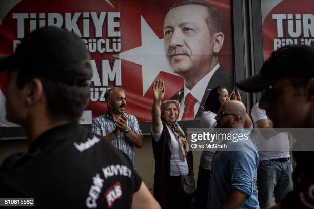 A supporter of Turkey's main opposition Republican People's Party leader Kemal Kilicdaroglu waves to the crowd in front of a poster of Turkey's...