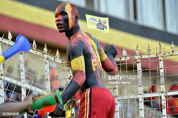 A supporter of Uganda National team is seen prior to the 2018 World Cup qualifying Group E football match between Uganda and Congo at the Mandela...