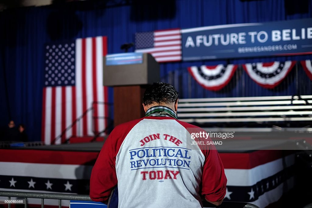 A supporter of US Democratic presidential candidate Bernie Sanders arrives for primary night rally in Concord, New Hampshire, on February 9, 2016. / AFP / JEWEL SAMAD