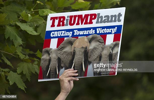 A supporter of US Republican Presidential hopeful Donald Trump holds up a sign during a Tea Party rally against the international nuclear agreement...