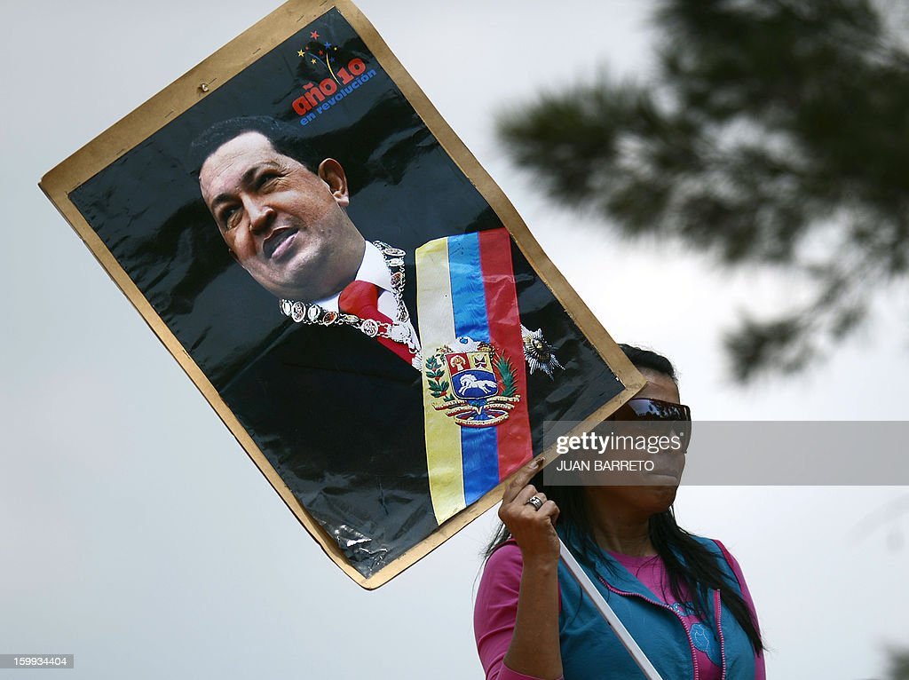 A supporter of Venezuelan President Hugo Chavez attends a rally during the commemoration of the 55th anniversary of the end of the dictatorship (1952-1958) of Marcos Perez Jimenez in Caracas on January 23, 2013. Thousands of Venezuelans marched in support of cancer-stricken President Hugo Chavez in Caracas Wednesday on the anniversary of the day the country's last dictator was overthrown.