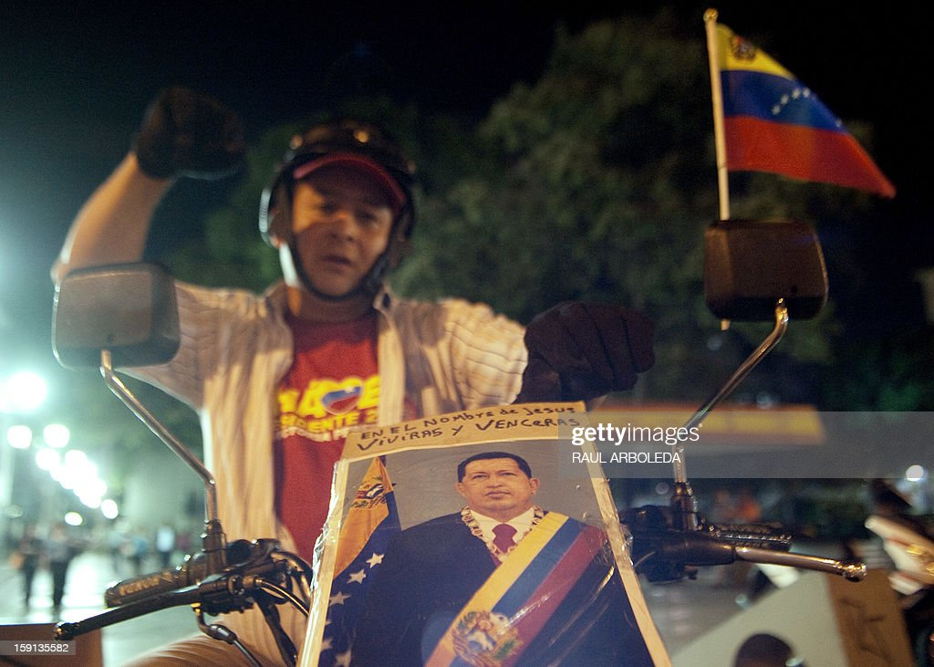 A supporter of Venezuelan President Hugo Chavez gestures in Caracas on January 8, 2013. The President of the National Assembly Diosdado Cabello announced today that due to health reasons, Chavez will not be able to take the oath to be sworn in for a fourth term in office next January 10. A constitutional fight intensified with the government planning a massive show of support in the streets on the day he is supposed to be sworn in. Chavez, who underwent his fourth round of cancer surgery in Havana nearly a month ago, is suffering from a severe pulmonary infection that has resulted in a respiratory insufficiency. AFP PHOTO/Raul ARBOLEDA