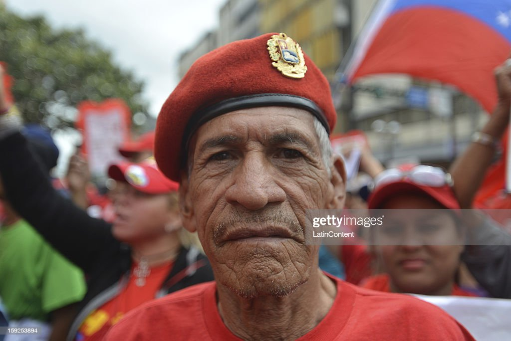 A supporter of Venezuelan President Hugo Chavez poses for a picture during a massive demonstration at Miraflores Presidential Palace on January 10, 2013 in Caracas, Venzuela. Chavez is now hospitalized in Cuba due to a cancer. Meanwhile, his followers back him up in the day a new presidential term is inaugurated without him. People make their way to Miraflores Presidential Palace to witness a symbolic swearing-in.