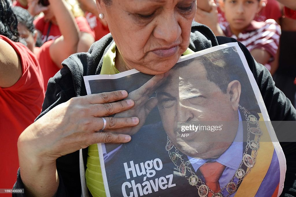 A supporter of Venezuelan President Hugo Chavez take part in a meeting outside Miraflores Presidential Palace in Caracas on January 10, 2013. With Chavez ailing and absent, Venezuela's leftist government launches a new presidential term with a display of popular support on the day he was to be inaugurated. The Supreme Court cleared the cancer-stricken president to indefinitely postpone his re-inauguration and said his existing administration could remain in office until he is well enough to take the oath.AFP PHOTO/Leo RAMIREZ