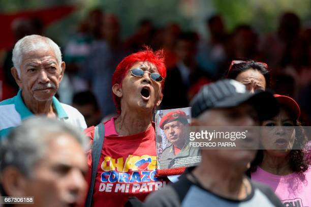 A supporter of Venezuelan President Nicolas Maduro sings the national anthem during a rally to commemorate 15 years of the coup that briefly removed...