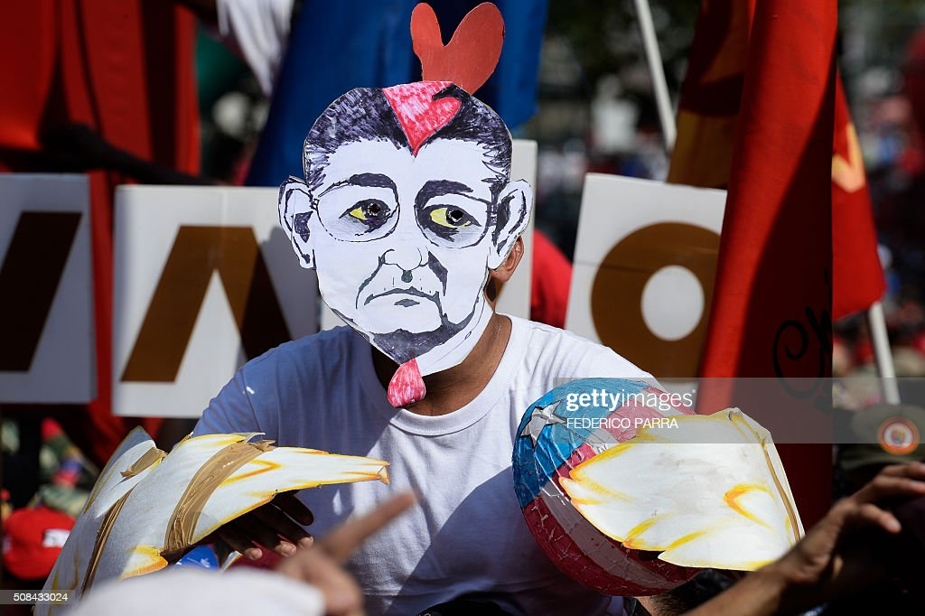 A supporter of Venezuelan President Nicolas Maduro wears a chicken costume and a mask with the face of the president of the oppositioncontrolled...