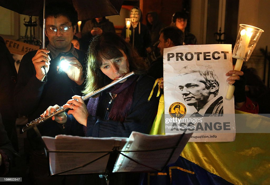 A supporter of Wikileaks founder Julian Assange plays music as she wait for him to speak at the Ecuadorian Embassy on December 20, 2012 in London, England. Mr Assange has been living in the embassy since June 2012 in an attempt to avoid extradition to Sweden where he faces allegations of sexual assault.