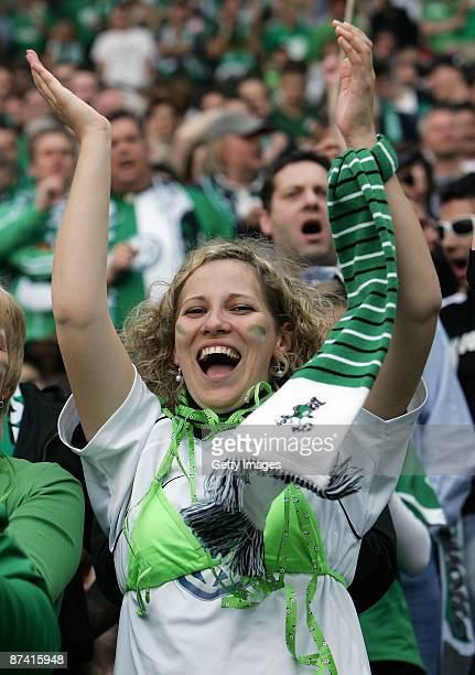 A supporter of Wolfsburg celebrates during the Bundesliga match between Hannover 96 and VfL Wolfsburg at the AWD Arena on May 16 2009 in Hanover...