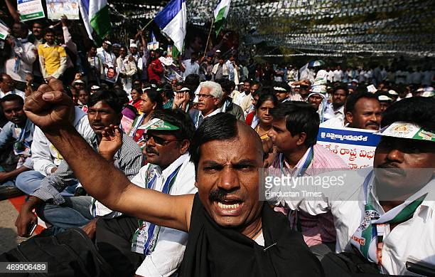 Supporter of YSR Congress Chief Jagan Mohan Reddy shaved his half head and moustache during their protest against the bifurcation of Andhra Pradesh...
