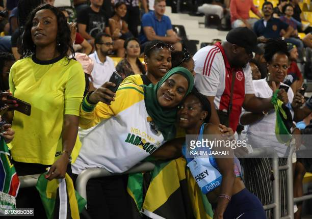 A supporter poses for a picture with Jamaica's Simone Facey during the Diamond League athletics competition at the Suhaim bin Hamad Stadium in Doha...
