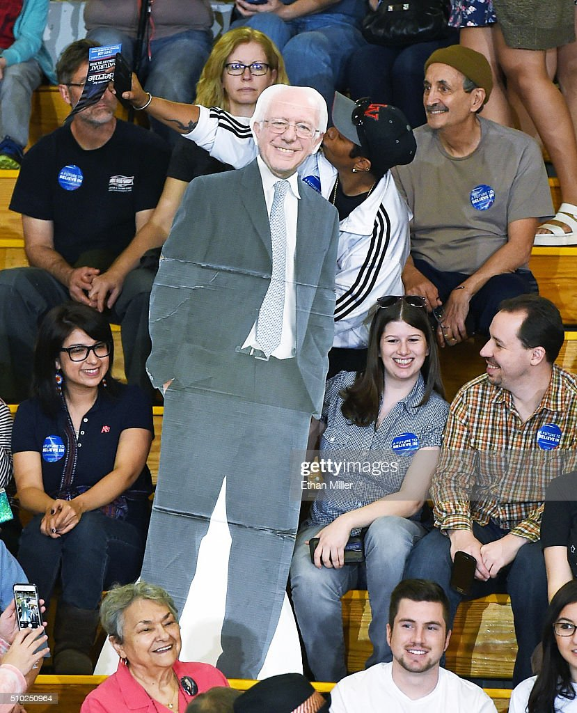 A supporter poses with a cardboard cutout of Democratic presidential candidate Sen. <a gi-track='captionPersonalityLinkClicked' href=/galleries/search?phrase=Bernie+Sanders&family=editorial&specificpeople=2908340 ng-click='$event.stopPropagation()'>Bernie Sanders</a> (I-VT) while waiting for him to speak at a rally at Bonanza High School on February 14, 2016 in Las Vegas, Nevada. Sanders is challenging Hillary Clinton for the Democratic presidential nomination ahead of Nevada's Feb. 20 Democratic caucus.